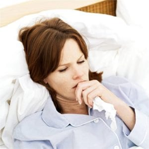 sick woman lying in bed