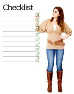 Woman ticking on a checklist