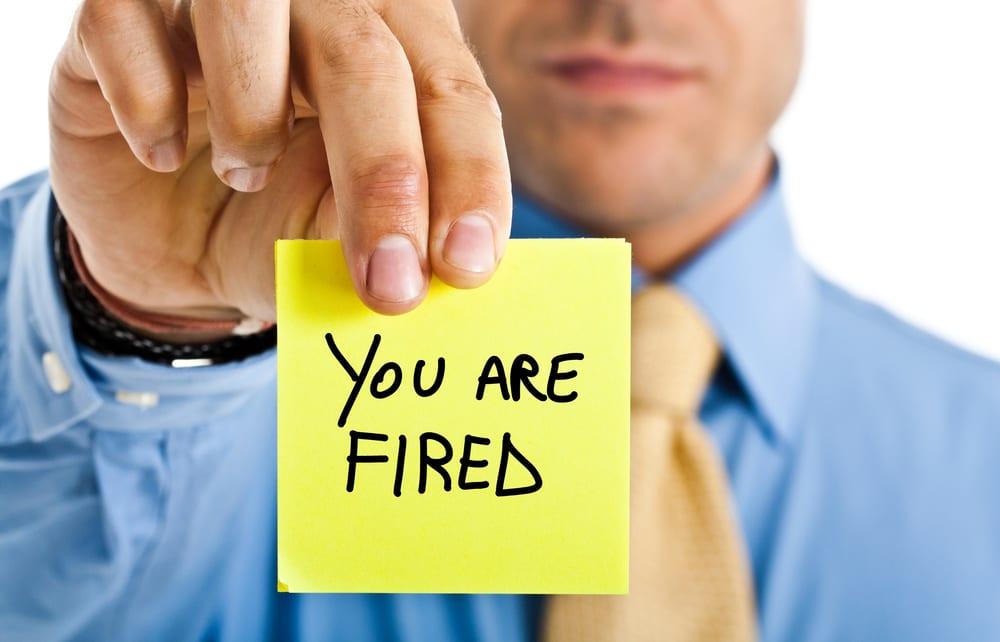 boss firing employee with a note