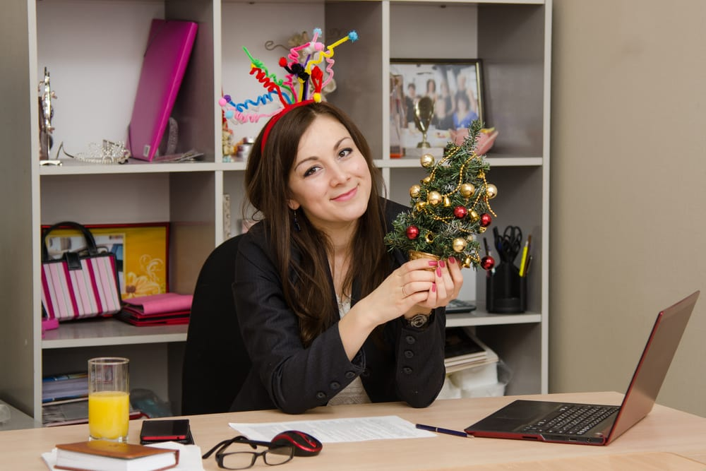happy employee with Christmas tree