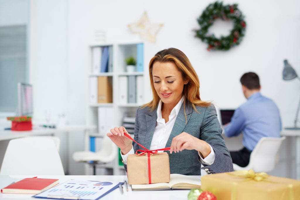 businesswoman opening a gift