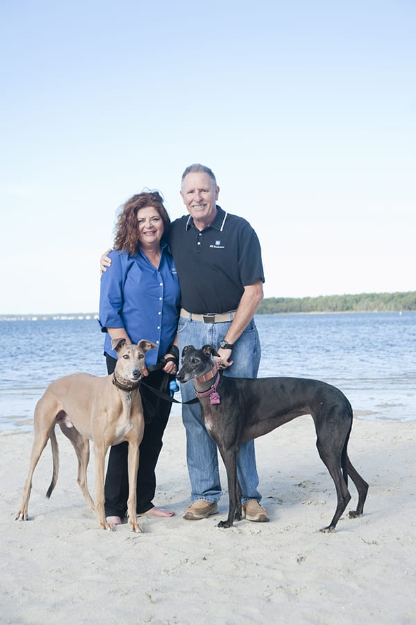 Mrs and Mr Young with family dogs on beach