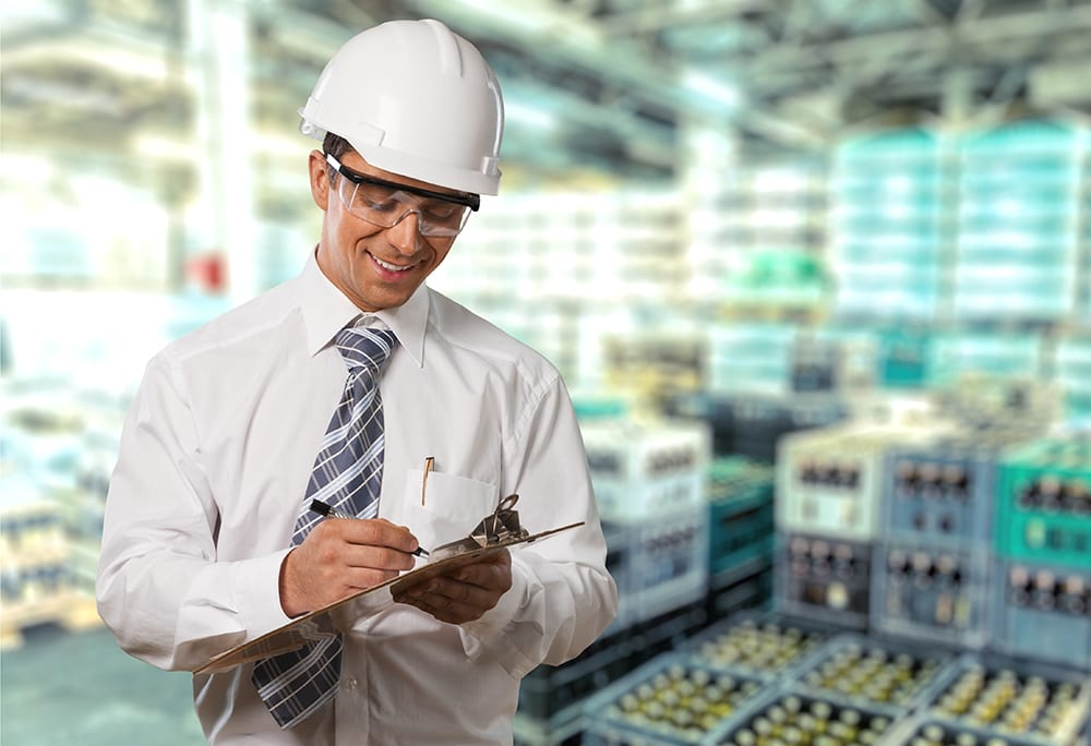OSHA regulator assessing safety in warehouse