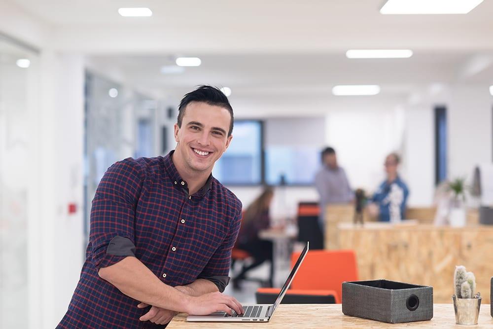 happy employee at desk