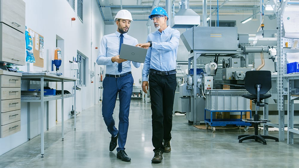two plant managers ensuring safety on walk through of plant